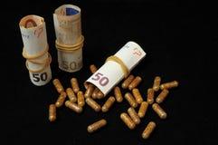 Pillen en geld Royalty-vrije Stock Foto's
