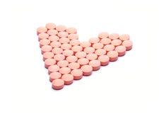 Pillen in hartvorm Royalty-vrije Stock Afbeeldingen