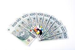 Pillen op de bankbiljetten Stock Foto