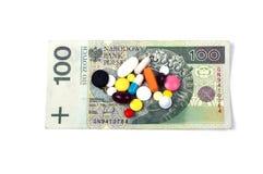 Pillen op de bankbiljetten Royalty-vrije Stock Afbeeldingen