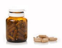 Pillen van fles Stock Foto's