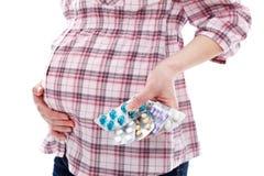 Pillen voor zwangere vrouw stock afbeeldingen