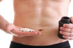 Pillenwiderstandtablette packt lokalisierten Ergänzungen Mann ein lizenzfreie stockfotos