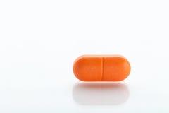 Pillola arancione Immagine Stock