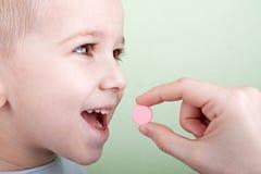Pillola del bambino Fotografie Stock Libere da Diritti