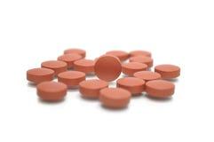 Pillola del Brown nella metà Immagine Stock