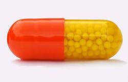Pillola multicolore con la medicina della versione di tempo Fotografia Stock Libera da Diritti