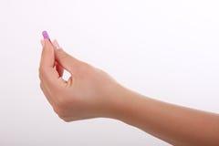 Pillola nella mano Fotografia Stock