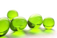 Pillole astratte nel colore verde Fotografie Stock Libere da Diritti