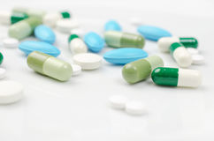 Pillole blu e verdi Fotografia Stock