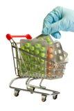 Pillole in carrello Immagine Stock