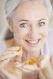 pillole che catturano donna Fotografie Stock