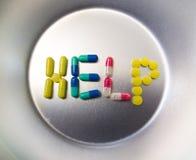 Pillole che compitano aiuto di parola immagine stock libera da diritti