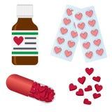 Pillole con le figure di cuore. Fotografia Stock