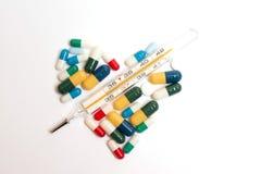 Pillole del cuore Immagini Stock Libere da Diritti