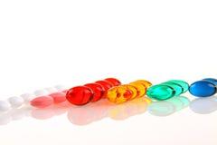 Pillole del gel su bianco Fotografie Stock