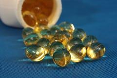 Pillole dell'olio di fegato di merluzzo Fotografia Stock