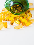 Pillole dell'olio di pesce fotografia stock libera da diritti