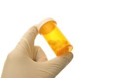 Pillole della mano Immagine Stock