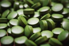 Pillole delle alghe verdi Fotografia Stock