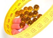 Pillole di misura e di dieta di nastro Fotografia Stock