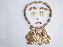 Pillole differenti sulla tavola Immagine Stock