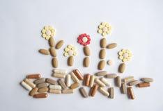 Pillole differenti sulla tavola Immagini Stock