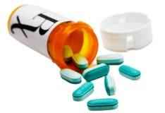 Pillole e bottiglia di pillola Fotografie Stock