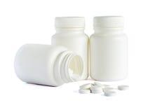 Pillole e bottiglie fotografie stock