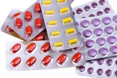 Pillole e capsule della medicina imballate in bolle Immagini Stock