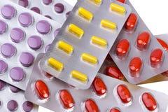 Pillole e capsule della medicina imballate in bolle Fotografie Stock