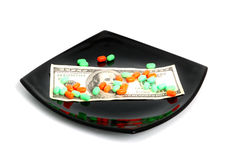 Pillole e cento dollari Fotografie Stock Libere da Diritti