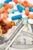 Pillole e dollaro della medicina Fotografia Stock Libera da Diritti