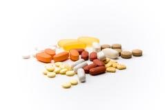 Pillole e farmaco di Issolated Immagine Stock