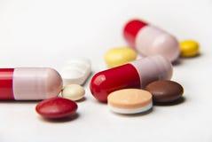 Pillole e ridurre in pani Fotografia Stock