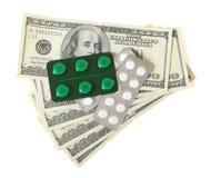 Pillole e soldi Fotografia Stock Libera da Diritti
