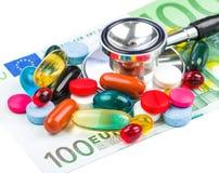 Pillole e soldi Immagini Stock Libere da Diritti