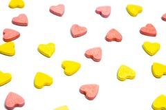 Pillole a forma di di sanità del cuore su fondo bianco Immagini Stock