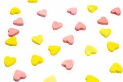 Pillole a forma di di sanità del cuore su fondo bianco Fotografia Stock