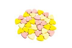 Pillole a forma di di sanità del cuore su fondo bianco Immagine Stock Libera da Diritti