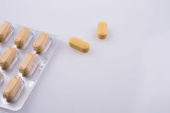 Pillole gialle Fotografia Stock Libera da Diritti