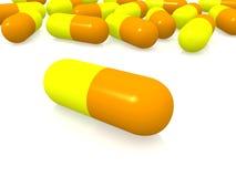 Pillole gialle ed arancioni Immagini Stock