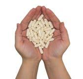 Pillole in mani Fotografia Stock