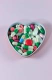 Pillole nel cuore Immagine Stock