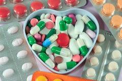 Pillole nel cuore Fotografia Stock