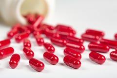 Pillole rosse Immagine Stock