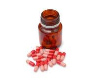 Pillole rosse degli antibiotici Immagine Stock