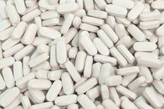 Pillole struttura e fondo della medicina Fotografie Stock