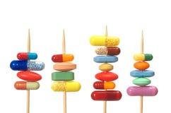 Pillole sui Toothpicks Fotografia Stock