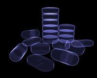 Pillole sul nero Immagine Stock